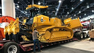 The World's largest bulldozer with a six way blade moving out of Conexpo 2017