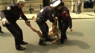 Topless Femen activists arrested in Paris