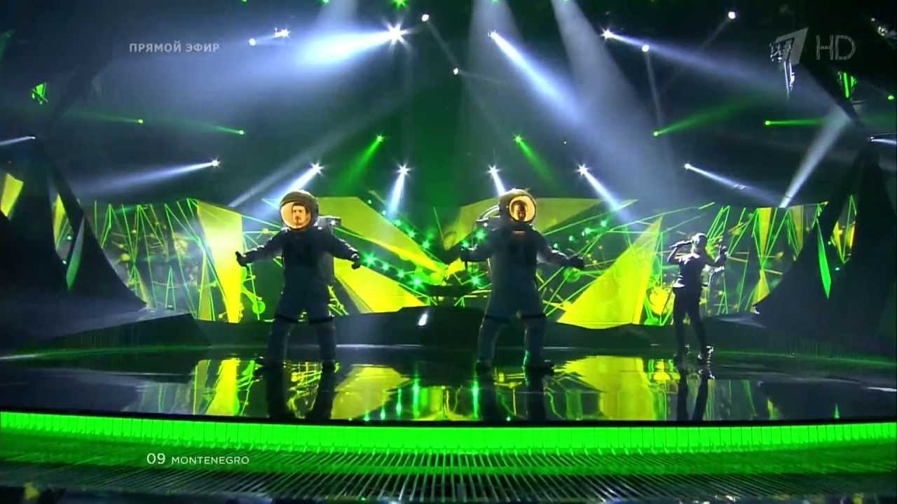 Singers in full spacesuits
