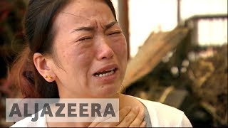 Survivors still grieving a year after devastating floods in China