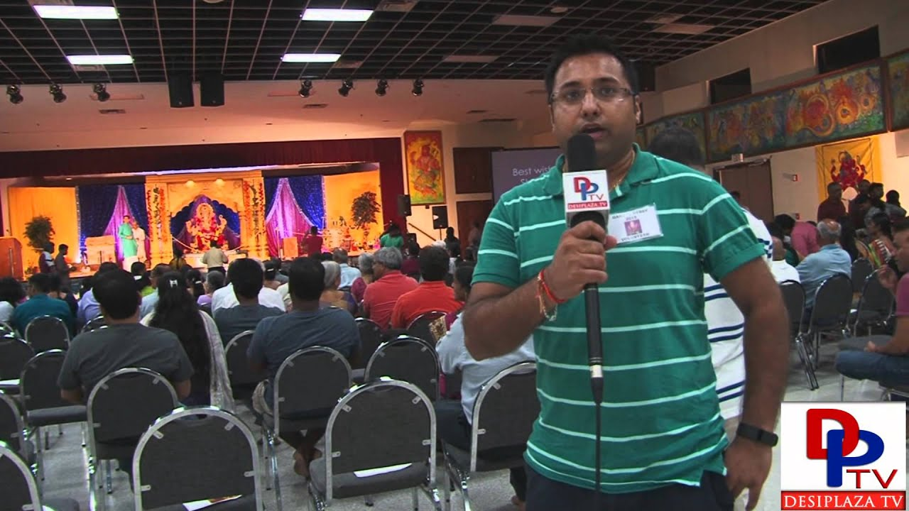 Volunteer from Siddhi Vinayak Ganpati Mandal speaking to Desiplaza TV