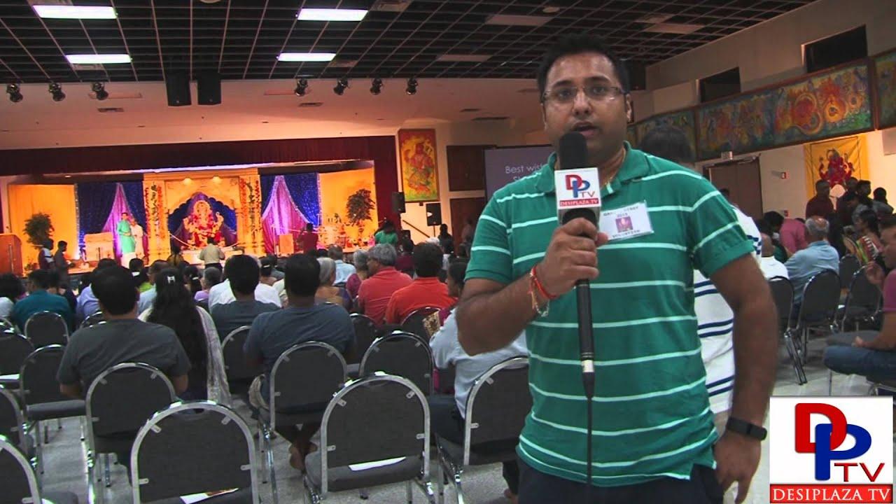 Volunteer from Siddhi Vinayak Ganpati Mandal speaking to Desiplaza TV