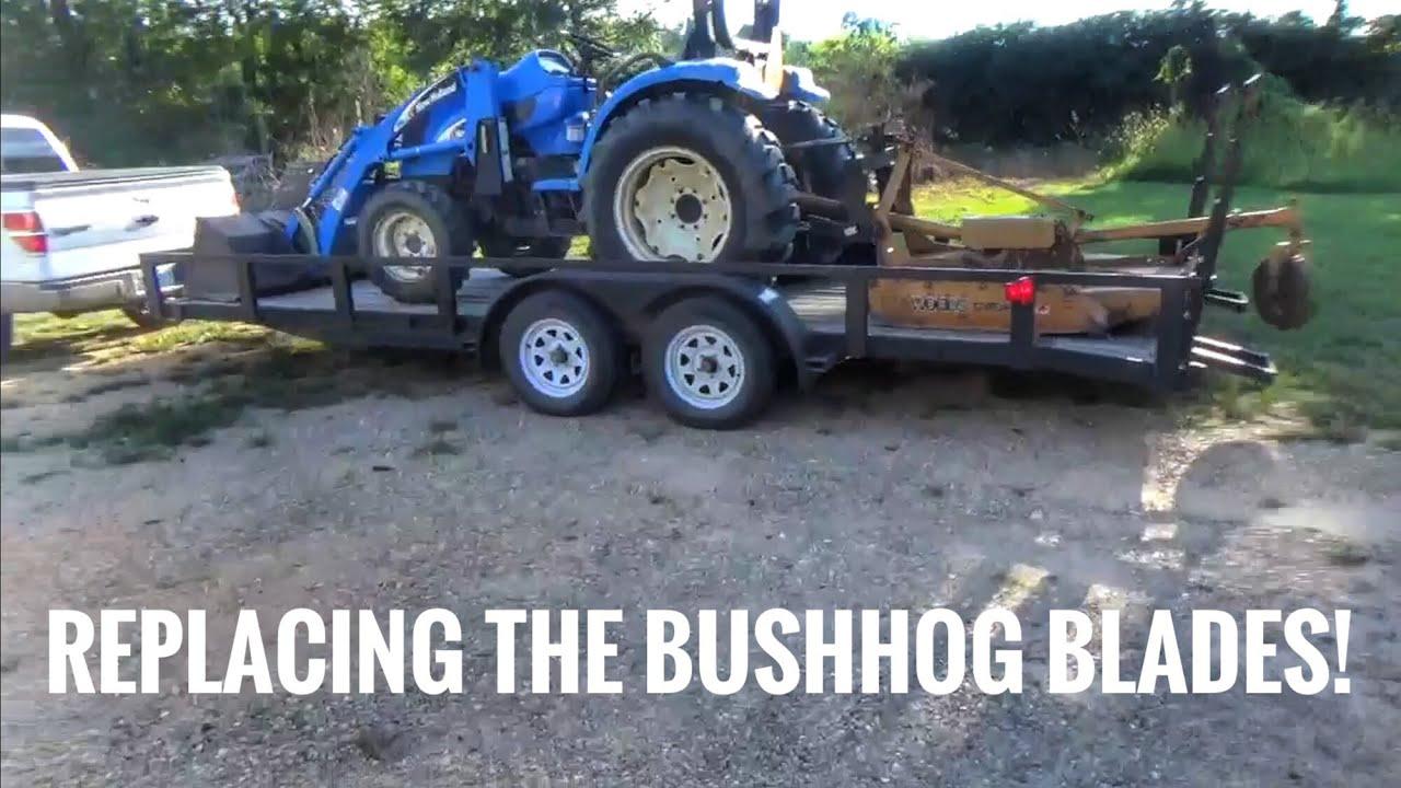 New bushhog blades on a Woods bushhog & A New Holland tractor