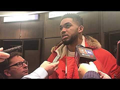 1/8/18: Karl-Anthony Towns talks to media while Jimmy Butler watches NCAA National Title game