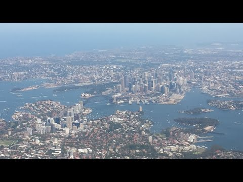 United Airlines UA 870 Boeing 777-200ER Sydney to San Francisco  (awesome view of downtown Sydney)