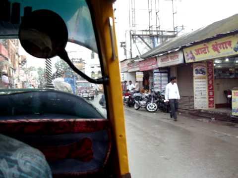 Auto-rickshaw ride in Varanasi monsoon