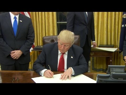 Watch: Trump signs executive orders on first day as President