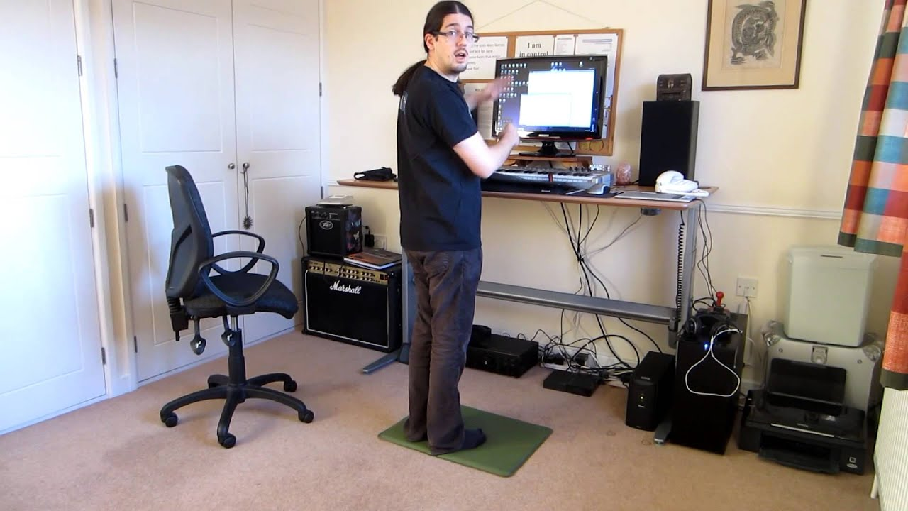 Jake Birkett demonstrating a motorised standing desk - YouTube