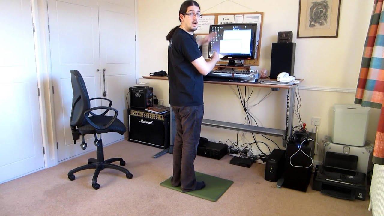 Jake Birkett demonstrating a motorised standing desk  YouTube