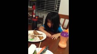 HILARIOUS! Falling asleep at dinner table, almost falls off chair!