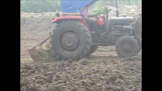 Use of tractors in the construction of fish ponds in India
