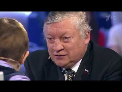 Download 3 years old boy plays chess with Former World Champion A Karpov