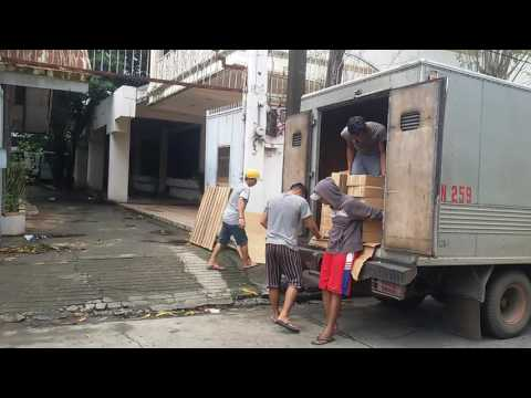 World Missionary Press-Unloading boxes of Bible booklets (The Filipino way)