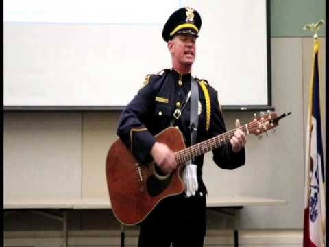 "Topeka Police Sgt. Jayme Green Performs the Song ""Sacrifice."""