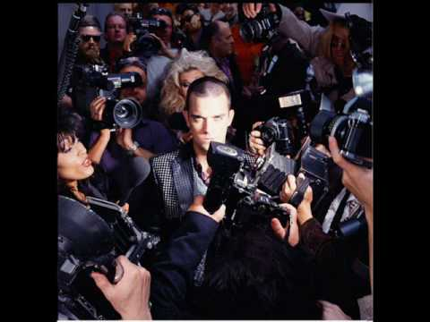 Robbie Williams life thru a lens with lyrics