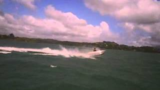 Small jet boat jumping off waves