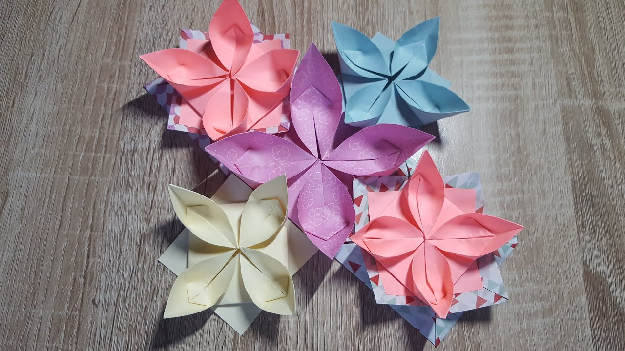 einfache origami blume falten wasserlilie how to make an origami water lily youtube. Black Bedroom Furniture Sets. Home Design Ideas