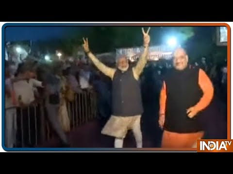 PM Modi arrives at party headquarter, greets people with victory sign
