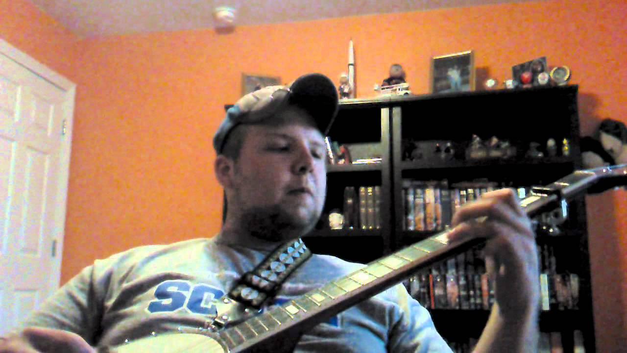 Logan Ackermann playing banjo