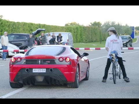 Guy on 207 MPH Bicycle Drag Races a Ferrari, Destroys It