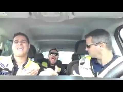 Singing cops in car