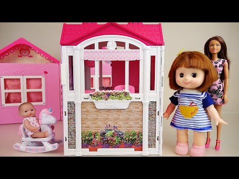 Baby doll and Barbie pink house toys