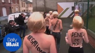 Femen protesters demonstrate as Marine Le Pen votes