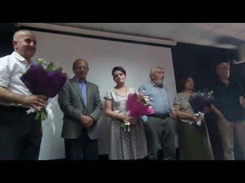 Said Abu Shakra gives flowers to Palestinian artists