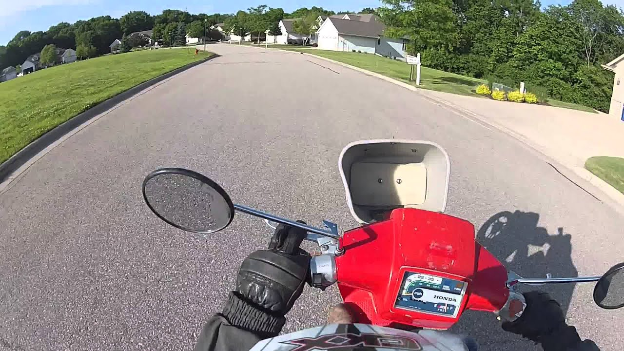 Pulling wheelies around town with the honda spree!!!