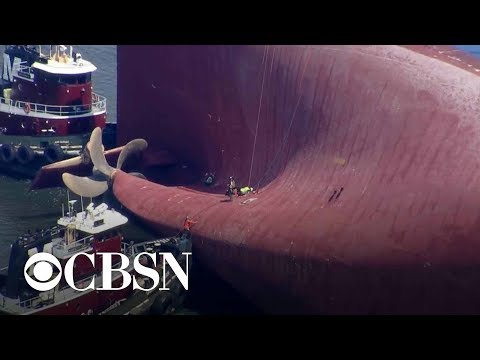 Walter Brown - Coast Guard makes contact with missing crew on overturned ship.