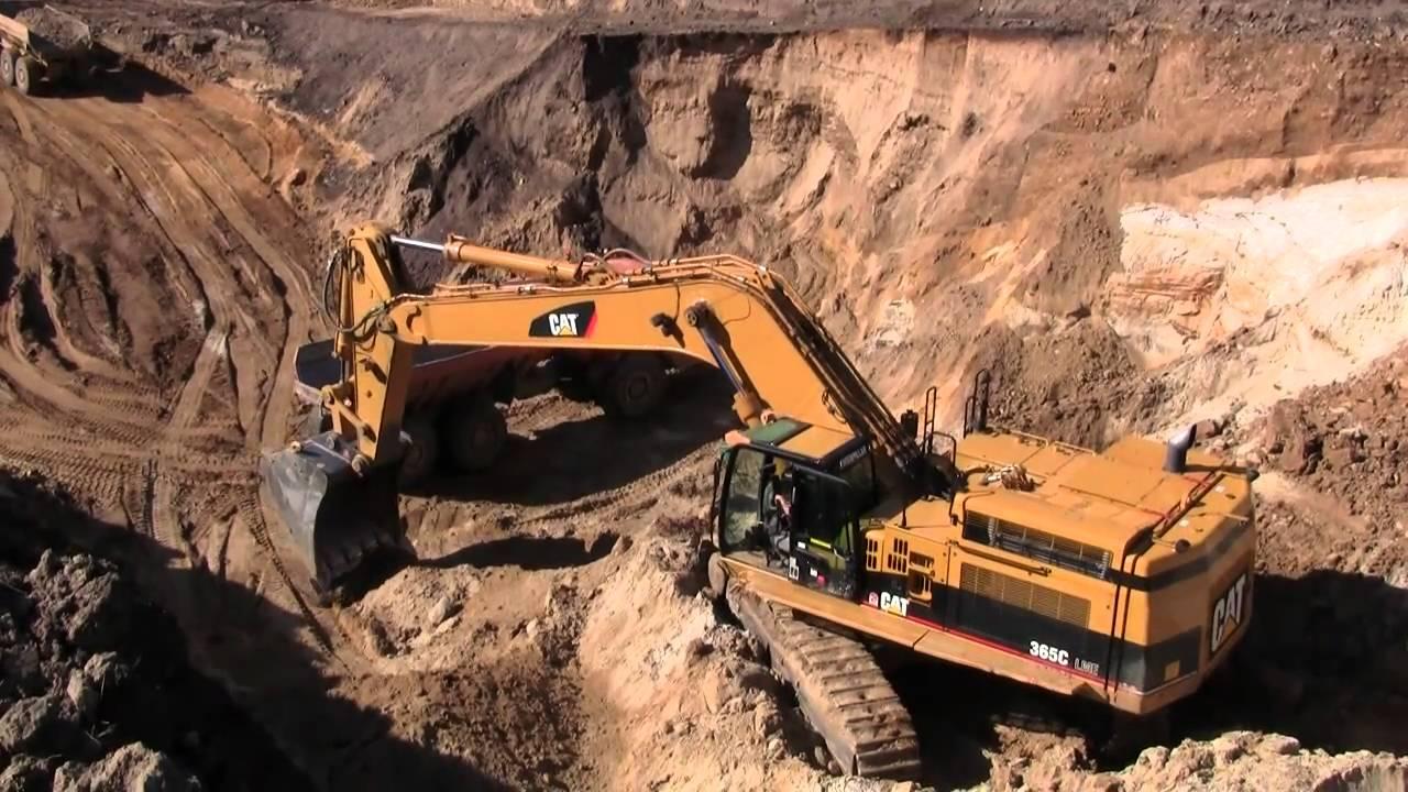 Cat 365C Long Reach Excavator Loading Volvo ADT's - YouTube