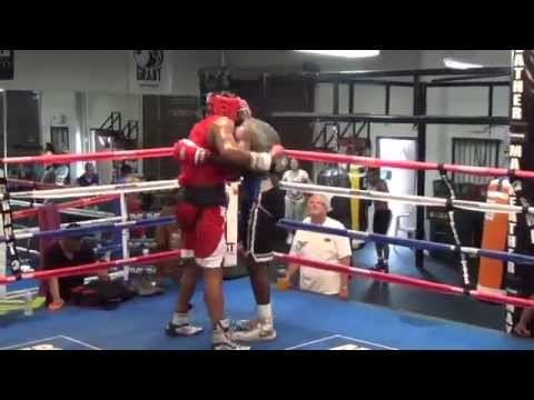 Michael Hunter spars Andrew Tabiti at the Mayweather Boxing Club