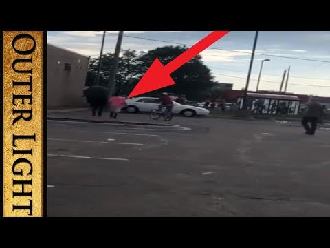 Video of umbrella man breaking windows