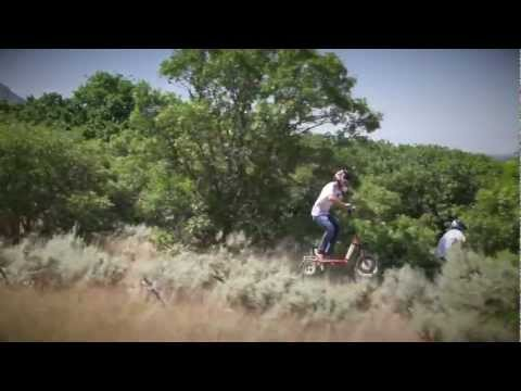 LYRIC Motion Electric Scooter: Trail riding on a mountain bike single track.
