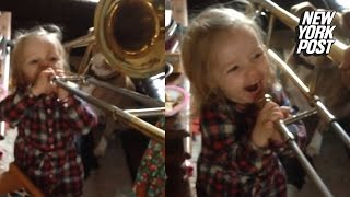 This baby trombone player blows