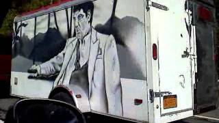 Scarface painted trailer towed by escalade