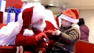 Kind-Hearted Santa Uses Sign Language to Discuss Presents with Little Girl