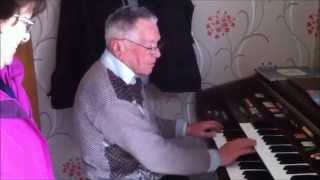Tommie Witney Playing his piano Keyboard   and Mouth Organ