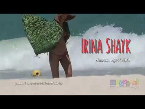 Irina Shayk almost suffers a wardrobe malfunction as string bikini slips. Cancun, Apr 2015