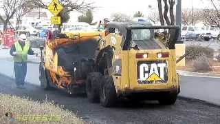 CAT 262 Skid Steer and CB 334 Asphalt Roller