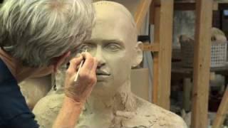 Tip Toland sculpting a bust at Seward Park Clay Studio