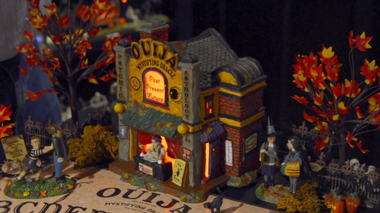 snow village halloween ouija village display demonstration by department 56
