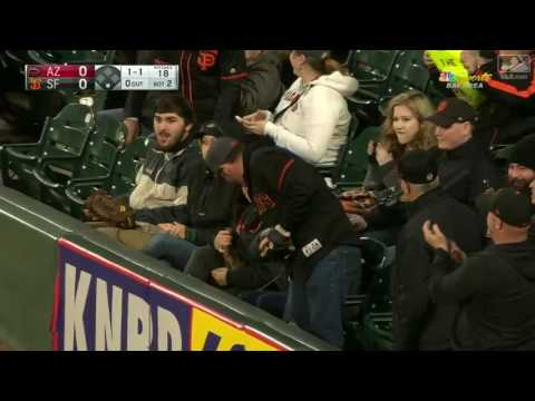 2017 Giants 41117 Nick Hundley hits a foul ball down the line in right and a fan reaches over the wa