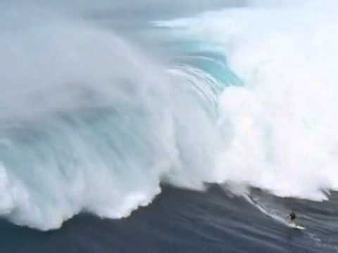 Surfing a Tsunami - Man surfs 65