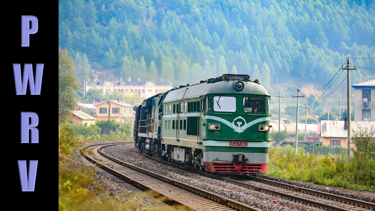 Download Chinese Railways - DF4B Diesel Assists a HXN5 With Freight Train Through Hengdaohezi, Northern China