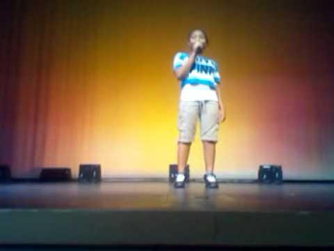 Jj singing at caleb Greenwood talent show