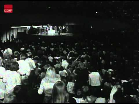 The Beatles on tour in the USA and playing on stage
