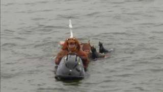 Santa dazzles spectators with his water-skiing skills