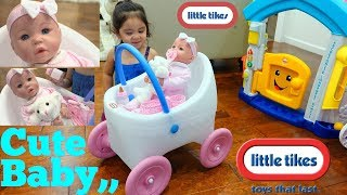 Very Cute Baby Doll Riding on a Stroller. Cute Toddler Pushing a Baby Stroller. Family Toy Channel