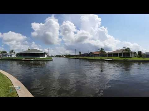 OVER 200 FT of WATERFRONT on desirable gulf access SAN CARLOS canal and intersecting Woodland Canal.